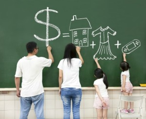family drawing money house clothes and video game symbol on the chalkboard
