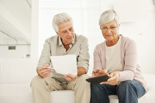 Retired couple discussing their financial budget at home
