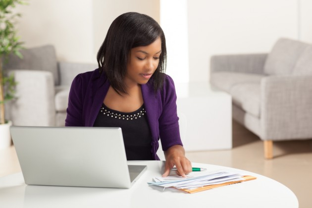Cute young black female doing finances